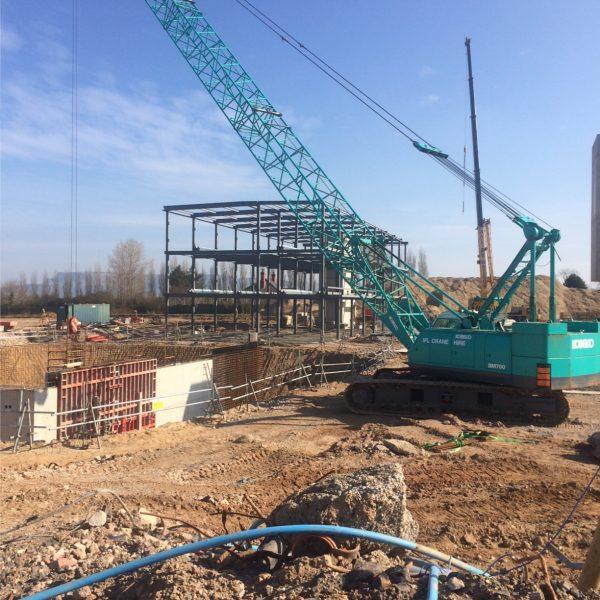 Crane operating ground engineering on a scottish construction site