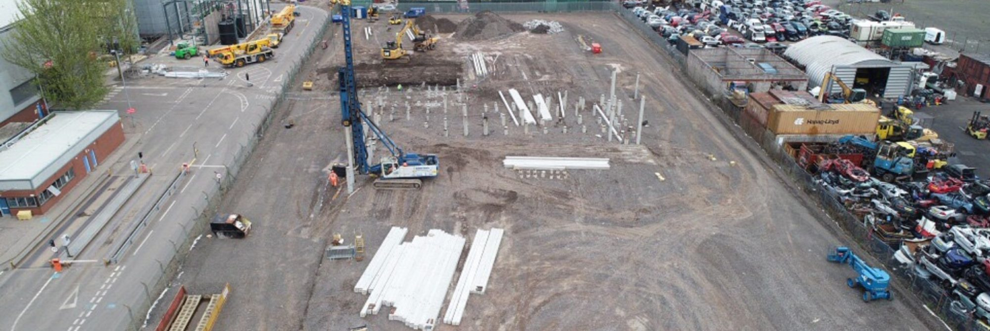Ground engineering site in Scotland with construction vehicles and materials nearby